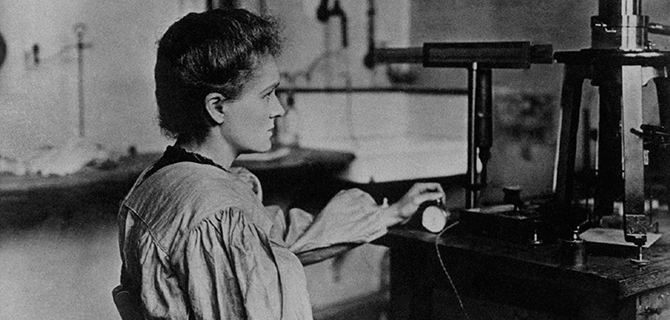 Women Scientists Honor Pioneers Like Marie Curie, shown here in her laboratory.